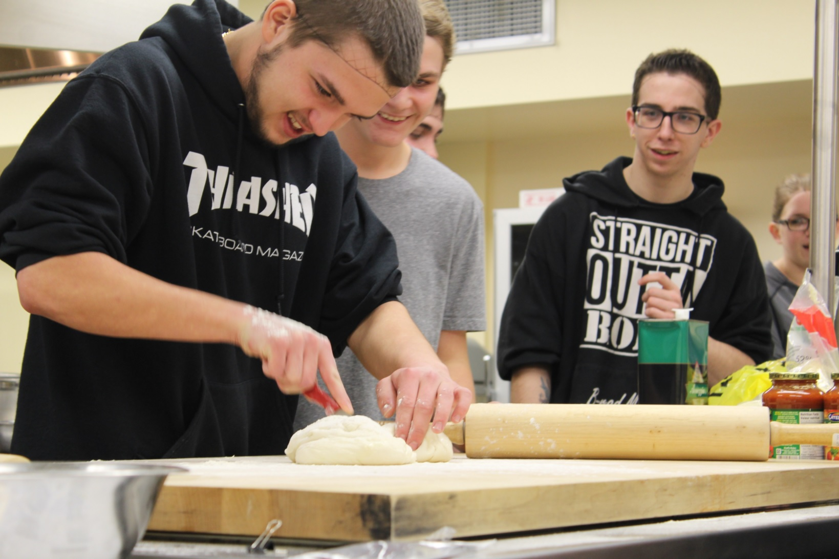 Discovery Collegiate students - Riley Hiscock, Shannon Collis and Brady Hobbs - crafting a nutritious pizza dough at the CNA Bonavista Campus. (Photo credit: C-NA)
