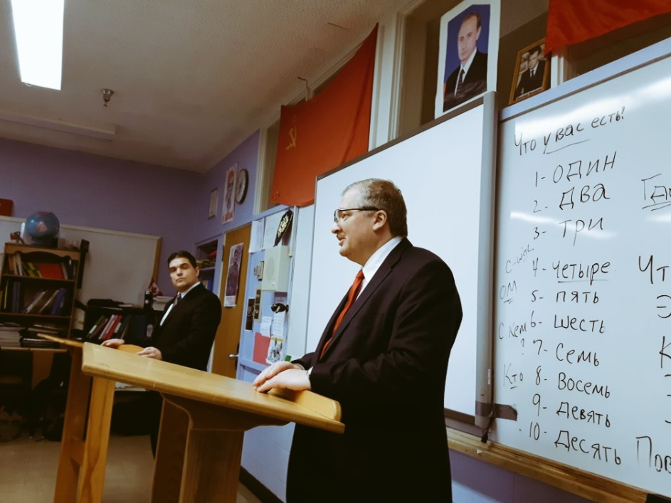 Teacher Rod Squires (R) introduces Russian Ambassador Alexander Darchiev to his PWC students.