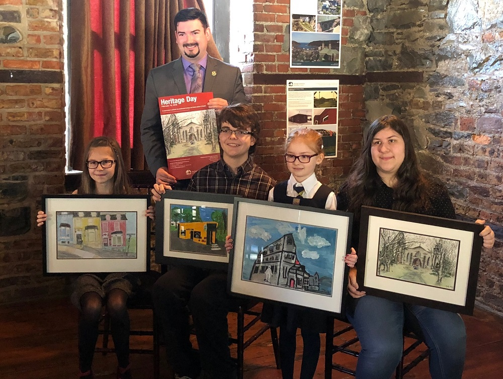 Minister Christopher Mitchellmore poses with this year's poster contest winners at an event at the Yellowbelly in downtown St. John's